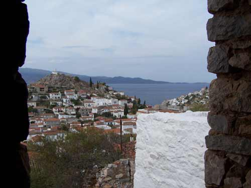 A part finished new stone house high up above the port with spectacular views of the island and the sea...