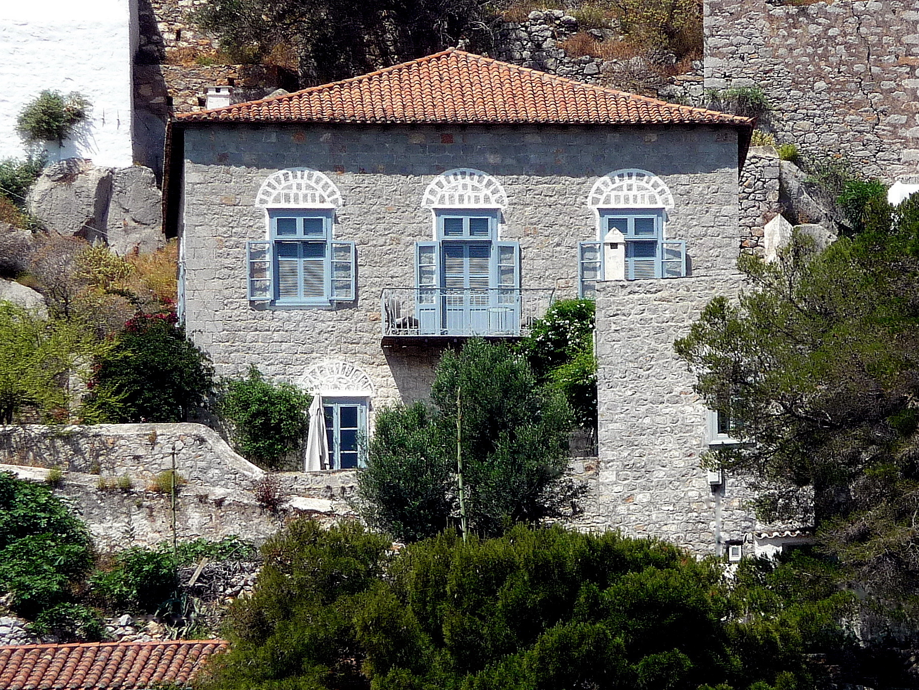 A lovingly-restored 18th-century aristocratic mansion set atop a hillside immediately overlooking the quaint Hydra harbour