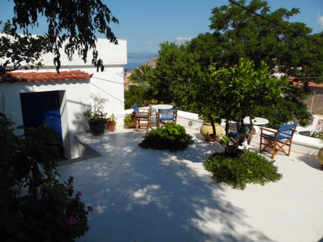 A wonderful Hydriot villa built of stone in the traditional manner with modern interiors, offering views over Hydra town, Kamini and the sea.